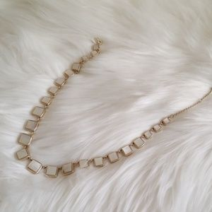 Goldtone and marble colored necklace
